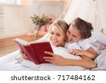 family. mother with daughter in ... | Shutterstock . vector #717484162
