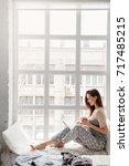 smiling woman sitting near... | Shutterstock . vector #717485215