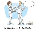 happy young woman in business... | Shutterstock .eps vector #717491026