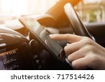 woman driving a car with using... | Shutterstock . vector #717514426