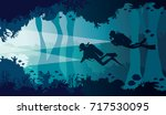 silhouette of two scuba divers... | Shutterstock .eps vector #717530095
