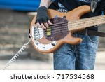 hands of bassist playing a... | Shutterstock . vector #717534568