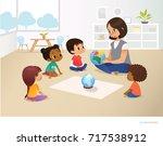 smiling kindergarten teacher... | Shutterstock . vector #717538912