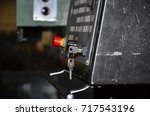machining of metal by cutting... | Shutterstock . vector #717543196