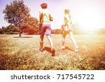 view at young couple running in ... | Shutterstock . vector #717545722