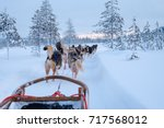 riding husky sledge in lapland... | Shutterstock . vector #717568012