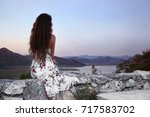 girl dreaming. view from the... | Shutterstock . vector #717583702