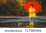 happy child girl with an... | Shutterstock . vector #717589396