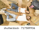the happy man and woman lay on... | Shutterstock . vector #717589936