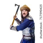 man the medieval warrior in armour and chain mail, viking with battle ax in hands isolated on white background, historical costume, man with long hair dressed in the style of the Middle