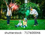 happy family all dirty of holi... | Shutterstock . vector #717600046