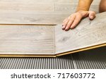 laying laminate flooring in a... | Shutterstock . vector #717603772