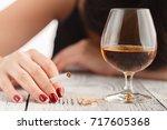 drunk woman holding an... | Shutterstock . vector #717605368