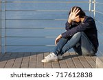 teenage girl with depression... | Shutterstock . vector #717612838