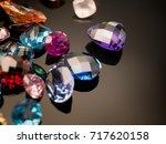 jewel or gems on black shine... | Shutterstock . vector #717620158