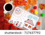 tea and drawing of the family.... | Shutterstock . vector #717637792