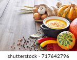 spicy pumpkin creme soup with... | Shutterstock . vector #717642796