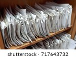 a cupboard full of paper files  ... | Shutterstock . vector #717643732