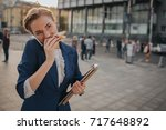 busy woman is in a hurry  she... | Shutterstock . vector #717648892