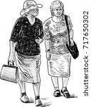 sketch of the elderly women on... | Shutterstock .eps vector #717650302