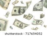 flying money on white background | Shutterstock . vector #717654052