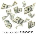 flying money on white background | Shutterstock . vector #717654058