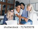 smiling black girl spending... | Shutterstock . vector #717655078