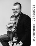 studio portrait of father and... | Shutterstock . vector #717665716