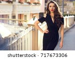 gorgeous female model with red... | Shutterstock . vector #717673306
