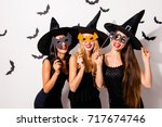 group of three diverse charming ... | Shutterstock . vector #717674746