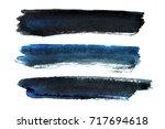 set of blue black brush strokes ... | Shutterstock . vector #717694618