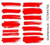 set of red brush strokes... | Shutterstock . vector #717694756