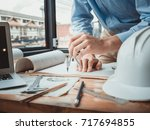 architect working on blueprint  ... | Shutterstock . vector #717694855