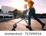 guy rubs his girlfriend in the... | Shutterstock . vector #717696916