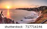 sunset over the ocean through a ...   Shutterstock . vector #717716146