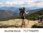 Hikers In The Mountains Of New...
