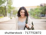 young smiling asia woman... | Shutterstock . vector #717752872