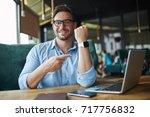 portrait of smiling businessman ... | Shutterstock . vector #717756832