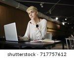 trendy dressed female web... | Shutterstock . vector #717757612