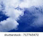 white cloud on the blue sky. | Shutterstock . vector #717765472