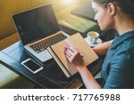 side view. young businesswoman... | Shutterstock . vector #717765988