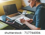 side view. young businesswoman... | Shutterstock . vector #717766006