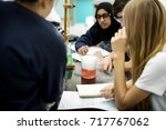 group of students laboratory... | Shutterstock . vector #717767062