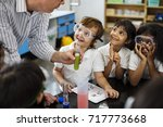 kindergarten students learning... | Shutterstock . vector #717773668