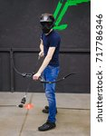 Small photo of Man with crossbow arrows bow. The Archer takes aim, sharpshooter. Crossbow club.