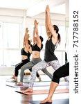group asian women stretching... | Shutterstock . vector #717788152