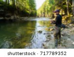 trout fishing in the mountain... | Shutterstock . vector #717789352