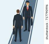 two businessmen meeting on... | Shutterstock .eps vector #717790996