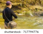 trout fishing in a mountain... | Shutterstock . vector #717794776