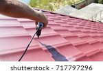 roofing contractor installing... | Shutterstock . vector #717797296